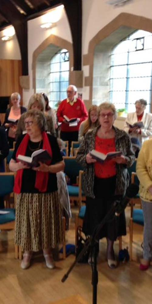 The congregation dressed in flame colours to remind us that we are Pentecost PeopleTall