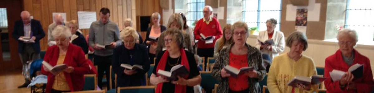 The congregation dressed in flame colours to remind us that we are Pentecost PeopleLong